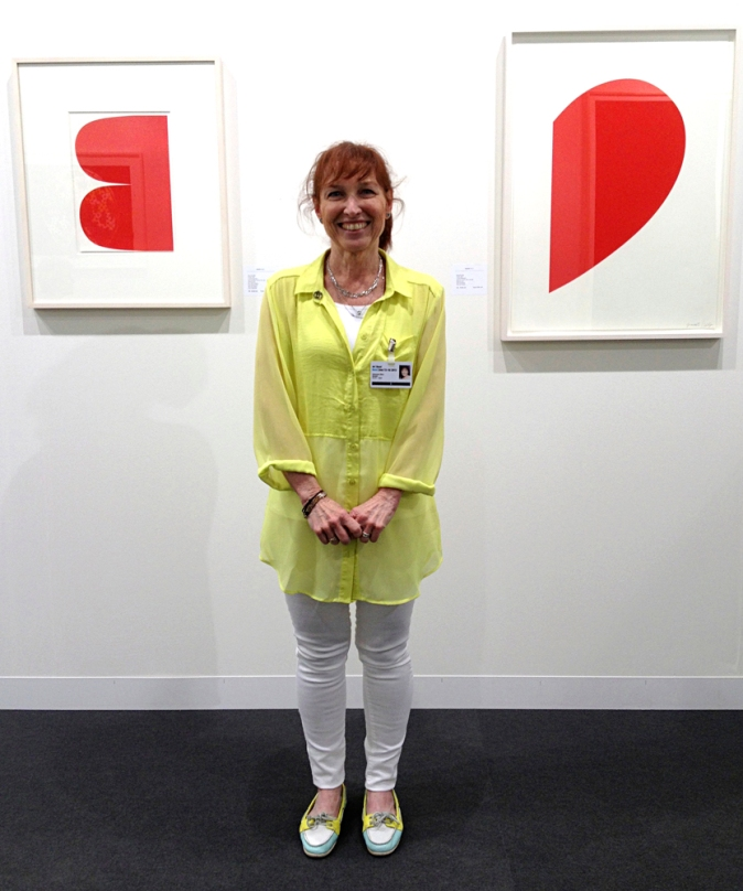 Ellen Grinstein Perliter of Gemini G.E.L. in Los Angeles in front of two new editions, by Ellsworth Kelly