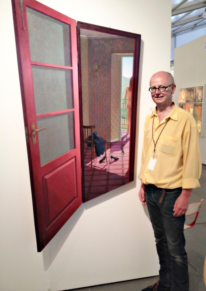 Paul Critchley with one of his three-dimensional works. You can actually open and close the door...