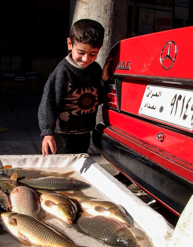 """Ahmed And The Fish"" - Baghdad 2002 © Jan Oberg 2002"